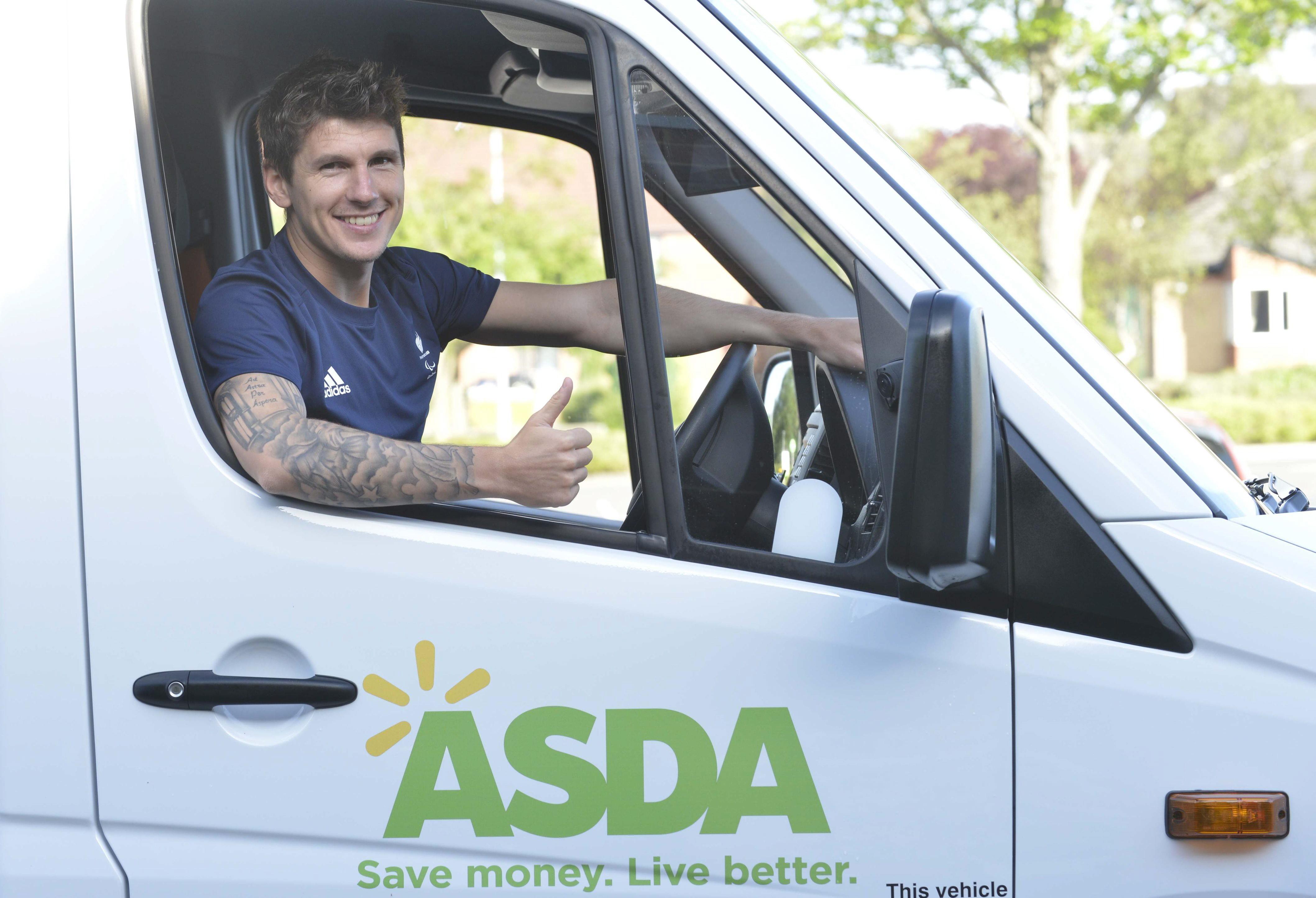 Asda Associate Matt Crossen sitting in an Asda truck