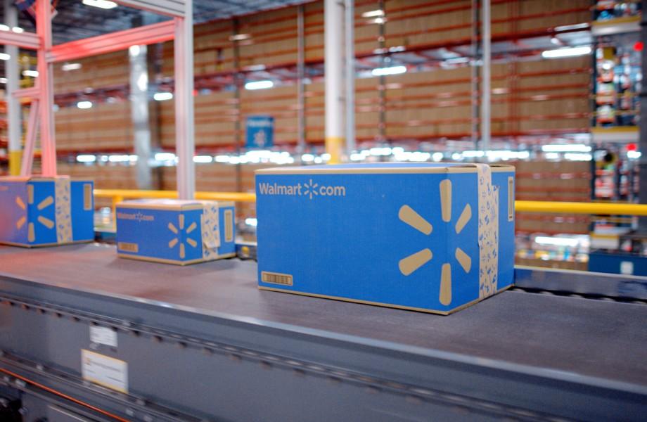 Walmart fulfillment center boxes moving down belt