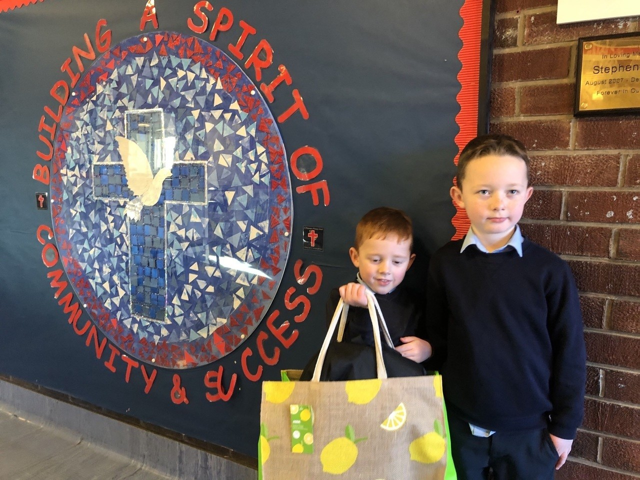 Kids from St Philomena's collect their laptops | Asda Robroyston