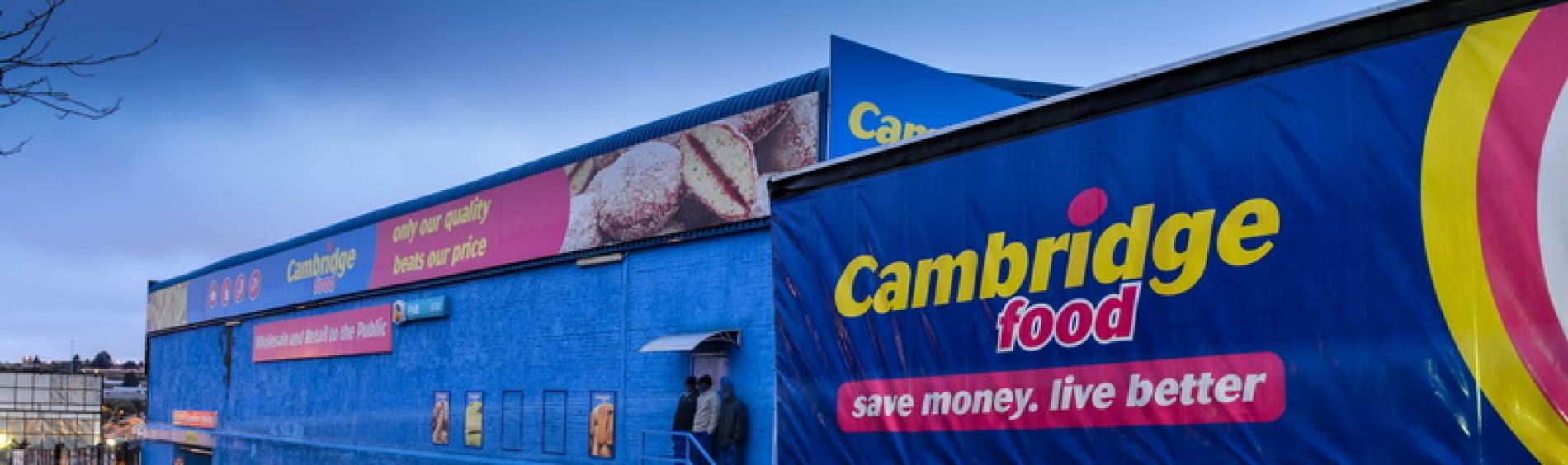 A Cambridge Food truck behind a Cambridge Food store