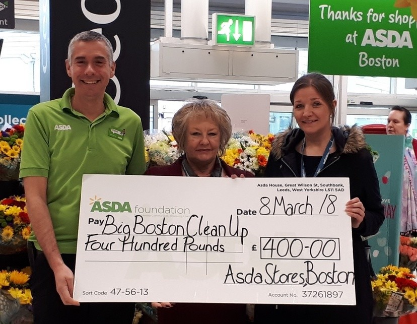 Asda Boston community champion Stephen Bromby hands over the £400 grant to big Boston clean up