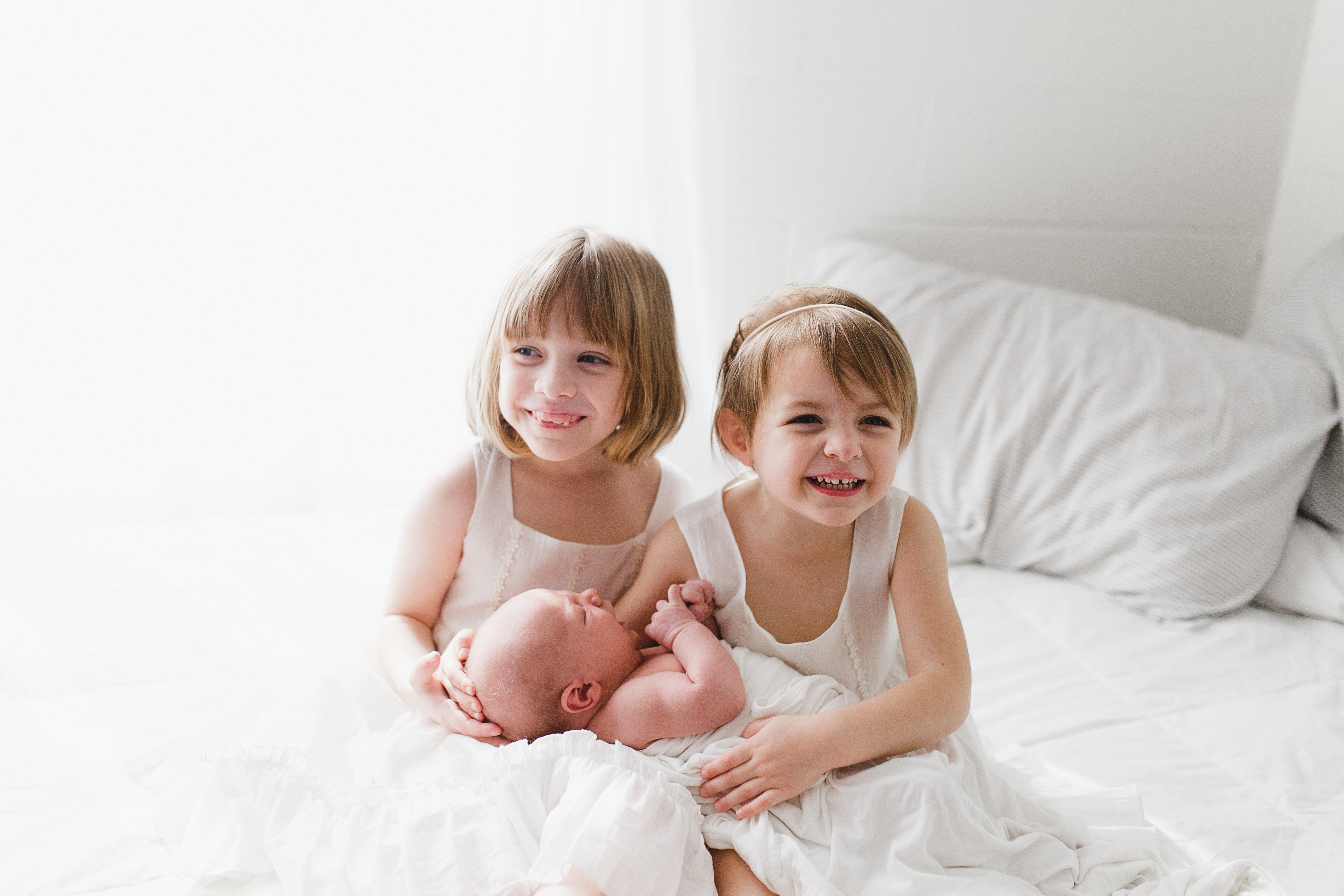 Carter girls holding baby brother