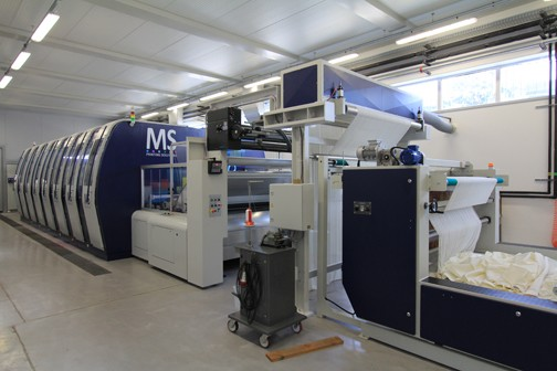 Large, industrial fabric printers are pictured at the LaRio Textile Manufacturing Lab