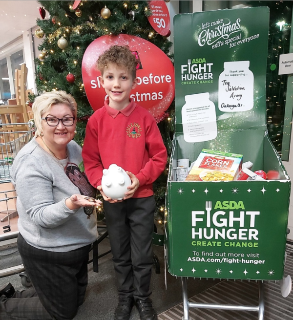 Seven-year-old George Jones spent all the money from his piggy bank in Asda Donnington Wood to help the local foodbank