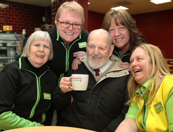 Blind customers Trevor enjoying a cuppa with colleagues at Asda Dunstable