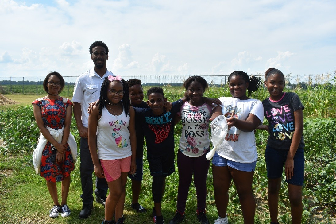 Campers pose outside the G.W. Henderson Community Center in Tunica, Mississippi