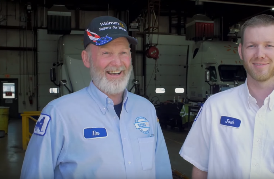 A son and father truck driver team laugh
