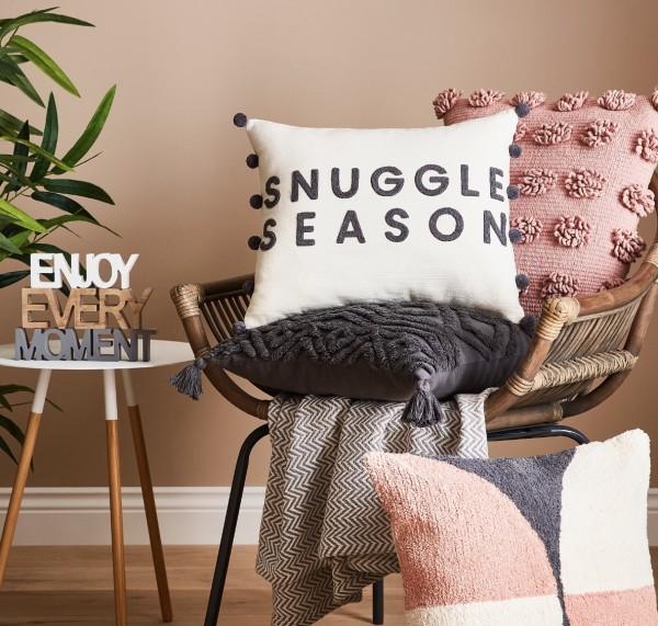 Pom Pom and slogan cushions