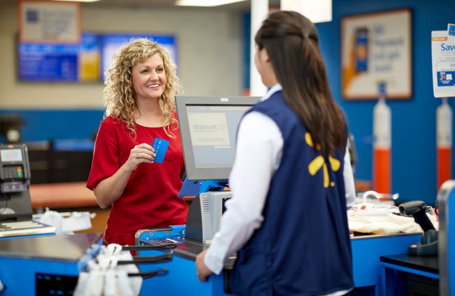 Female customer checks out using Walmart prepaid MoneyCard