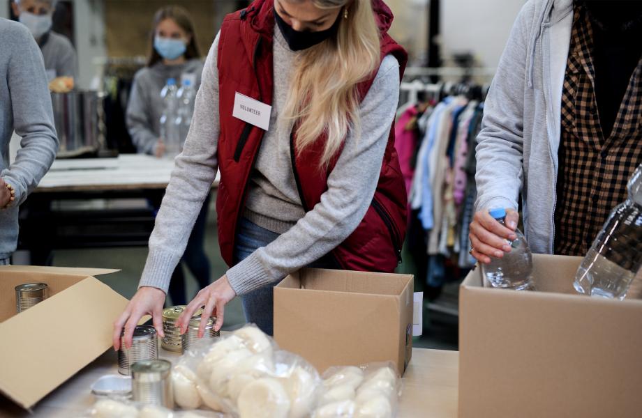 Person volunteering filling a box