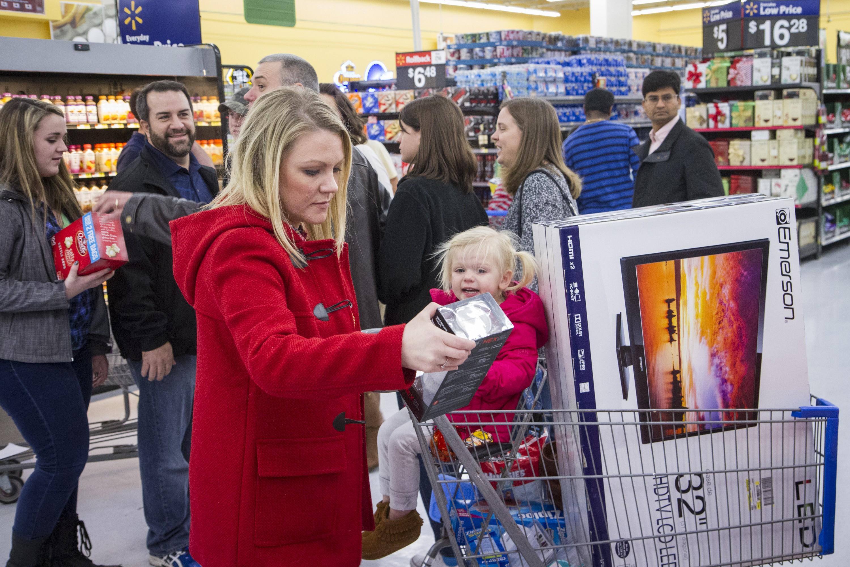 Liz Richardson and her daughter Aubrey fill their cart during Black Friday shopping at Walmart