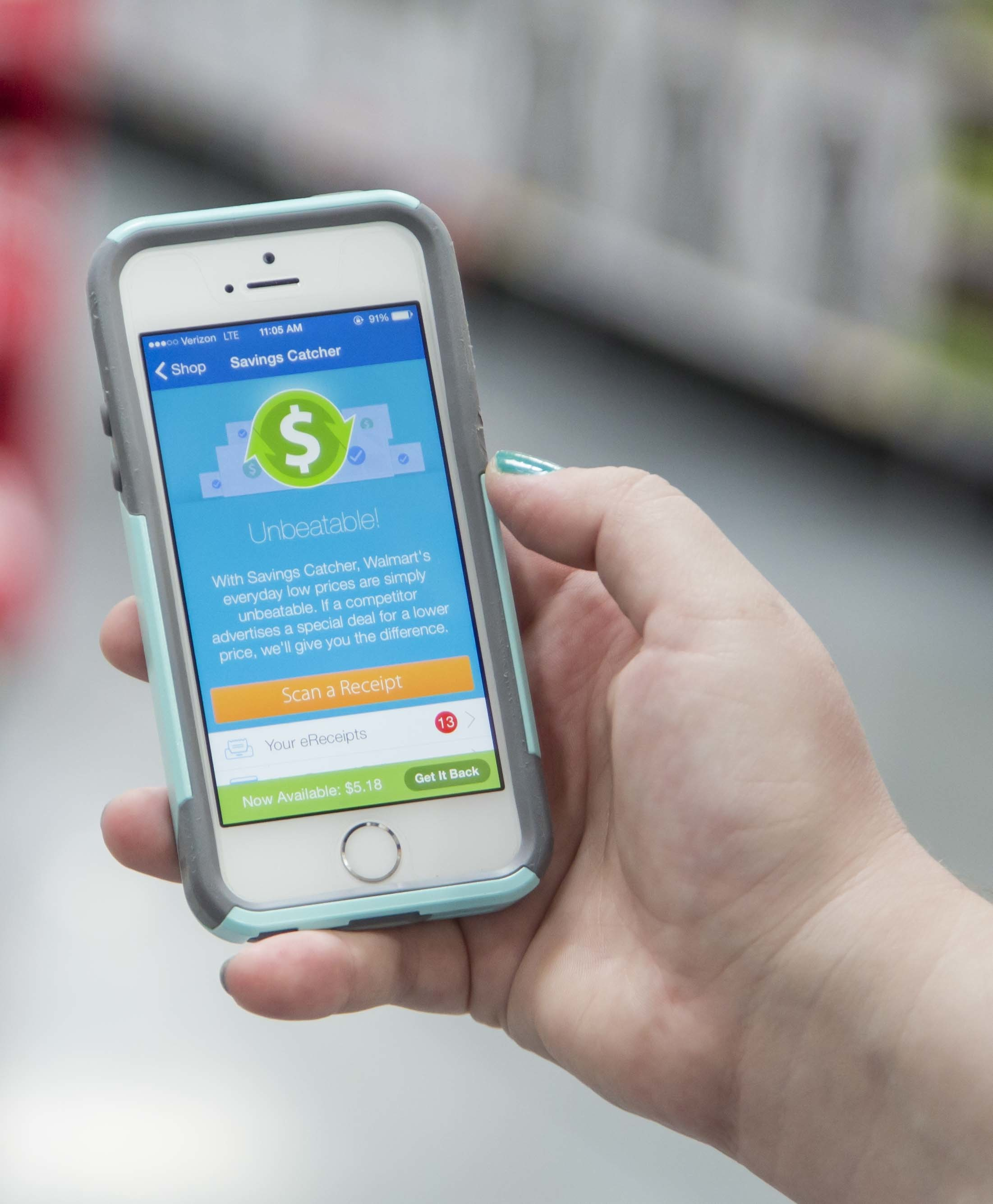 A customer uses Savings Catcher in Walmart's mobile app