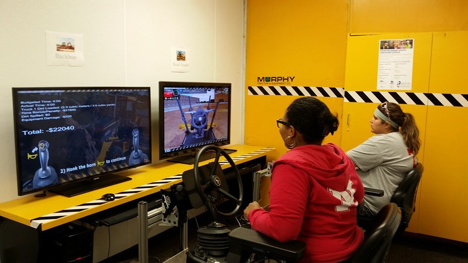 Two Women at Iowa Construction Simulation Stations