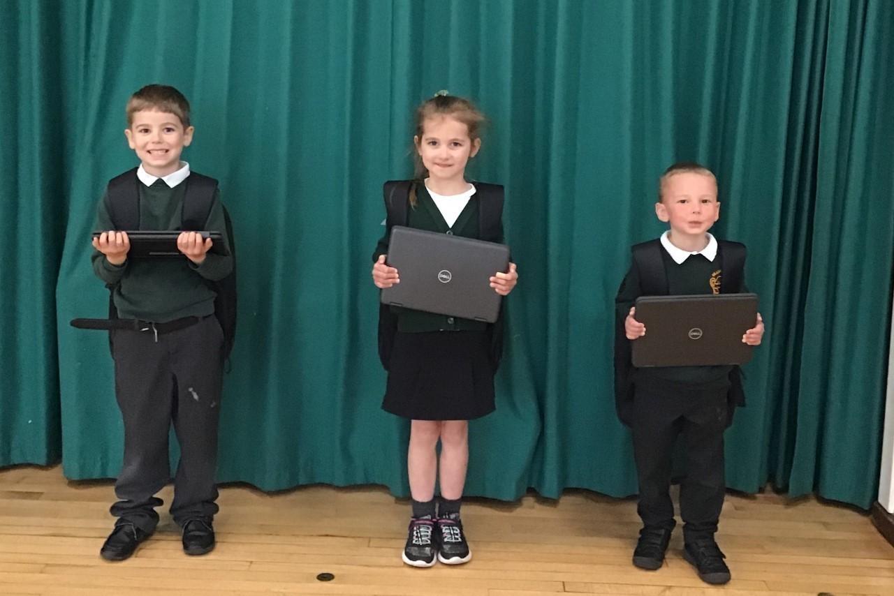 Gillingham Primary School receive their laptop donation   Asda Gillingham