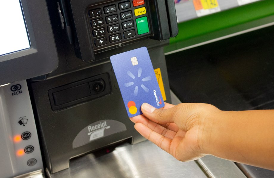 Customer using Walmart CapitalOne Card at register