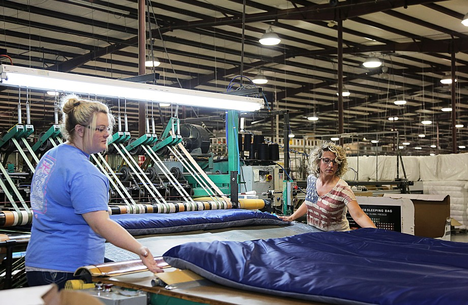 Two workers working on sleeping bags