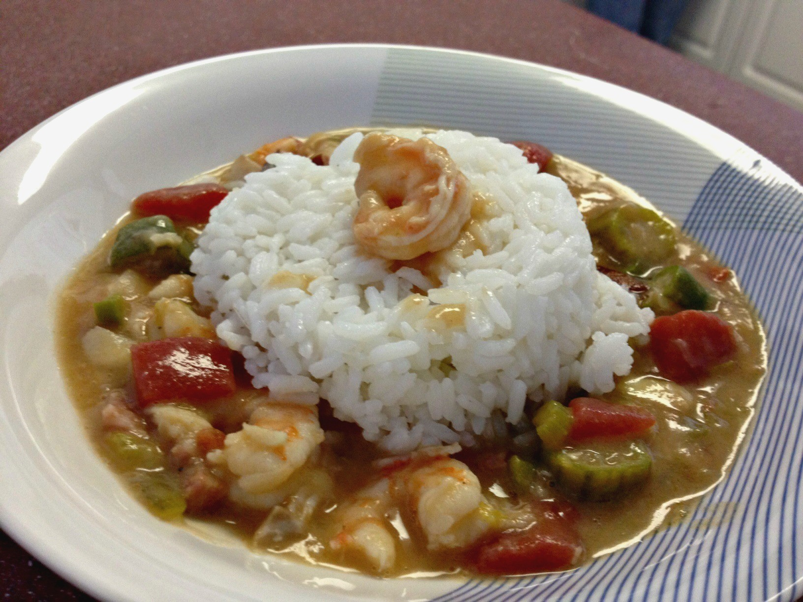Carolina Gumbaya is topped with white rice and is in a white bowl