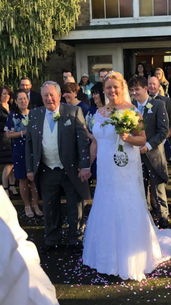 Wedding day picture of Sharon and Del Wing who met at Asda Stonecot Hill