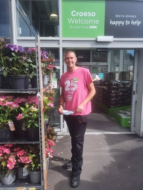 Retained firefighter Neil Shilvock from Asda Pwllheli supports Tickled Pink breast cancer charity campaign