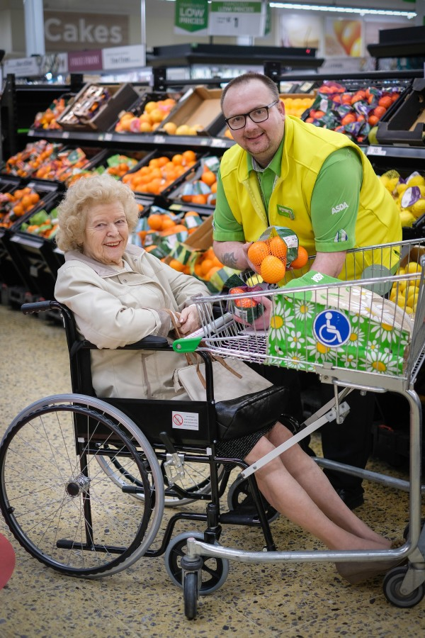 James Phelan from Asda Blackpool helps Gladys Dixon with her shopping