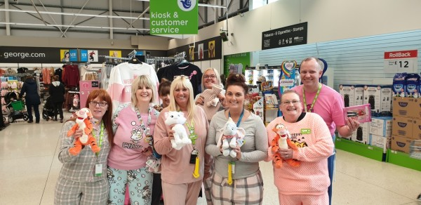 Asda Southport colleagues take part in Tickled Pink pyjama party