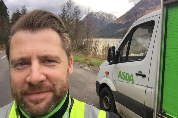 Robbie Hope with Asda van in picturesque scenery of North West Scotland