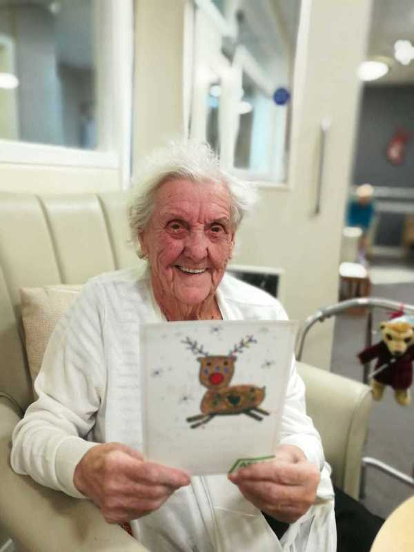 92-year-old care home resident Doris with her handmade Asda Christmas card