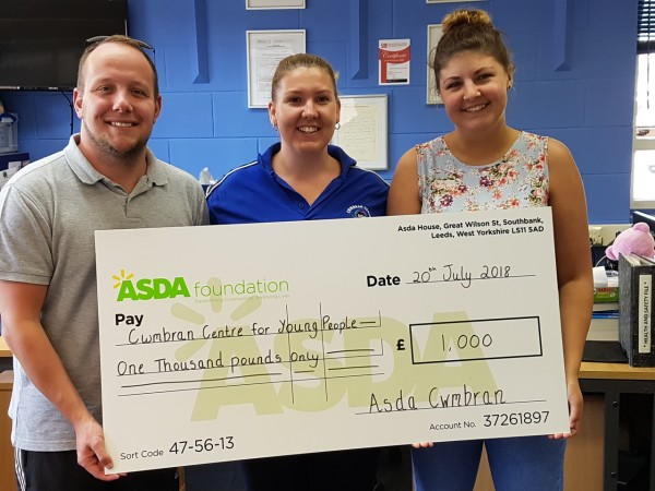 Kate Box from Asda Cwmbran presenting Cwmbran Centre for Young People with a Healthy Holiday Fund grant