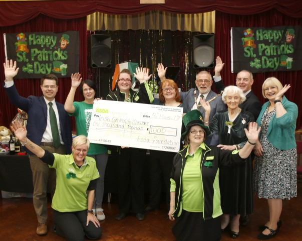 Caroline Pettican from Asda Charlton donates a cheque to Irish Community Services