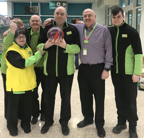 Asda Dundee Kirkton colleague Matthew White celebrating his Special Olympics call up with colleagues