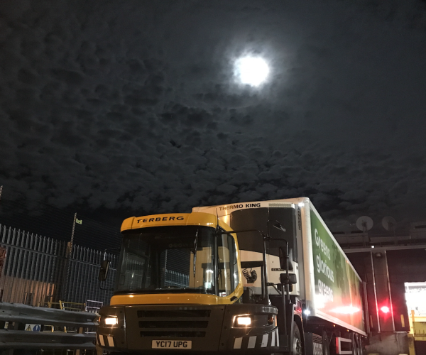 Asda lorry driver Ian McIlroy takes pictures on his delivery route