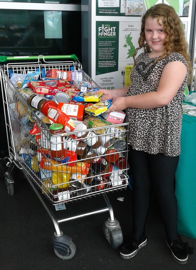 An Asda Bootle customer donating to a local foodbank