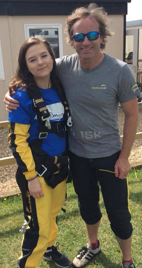Asda Highbridge colleague Leia Smith with a skydive instructor