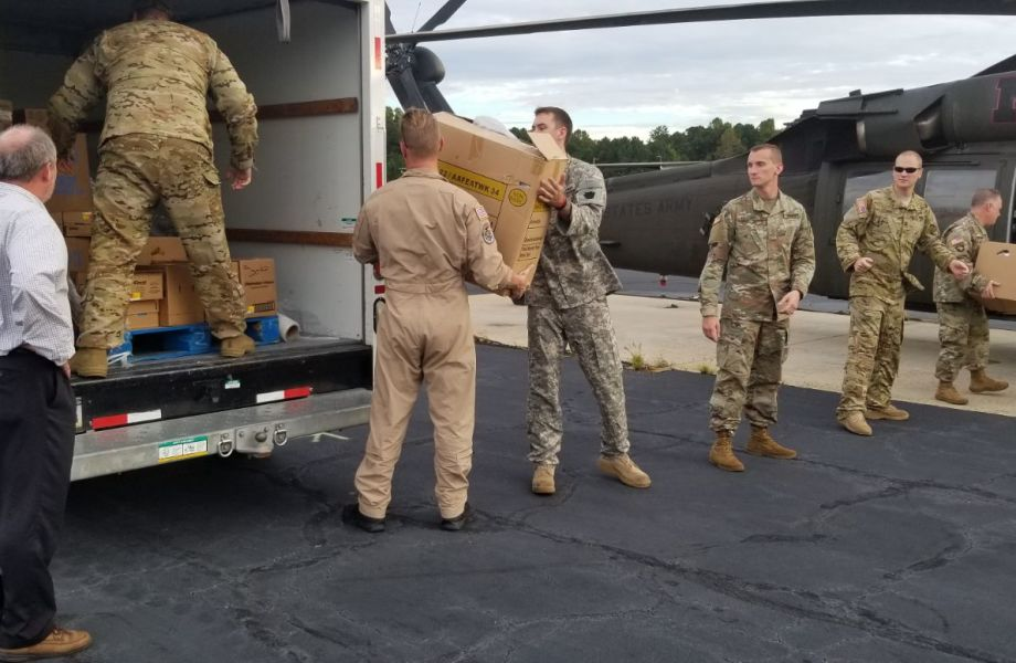 The North Carolina Air National Guard load supplies into a helicopter after Hurricane Florence