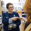 An associate uses the Walmart.com in-store app to help a customer purchase a Walmart.com item