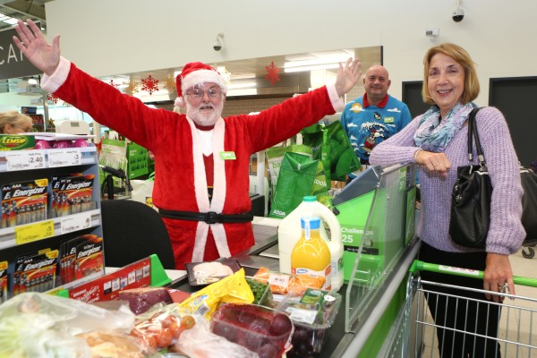 Asda Wrexham checkout colleague Jimmy Smith dresses as Santa