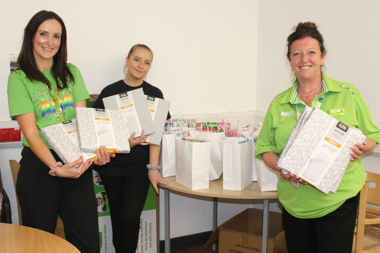 The Johnson F'oldies receive a donation from Asda Bolton, Burnden Park and Farnworth  | Asda Bolton