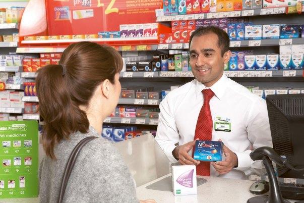Maq Din with a customer in Asda