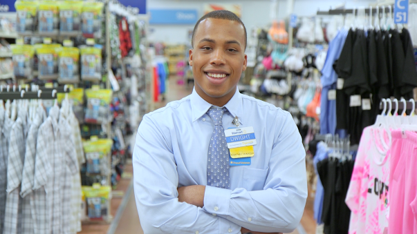 Man smiling in the aisle of a Walmart