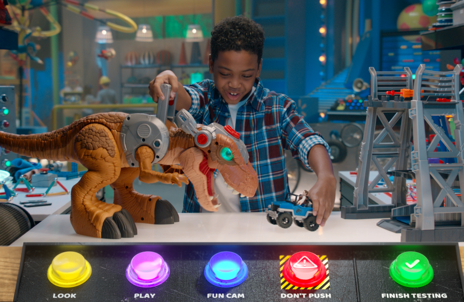 Burt, The Walmart Toy Lab host, plays with an Imaginext Jurassic World Jurassic Rex