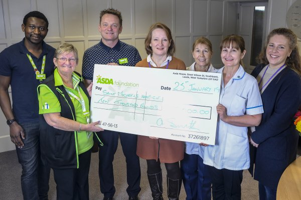 Angela Smith from Asda Harrogate presents a cheque for £10,000 to St Michael's Hospice