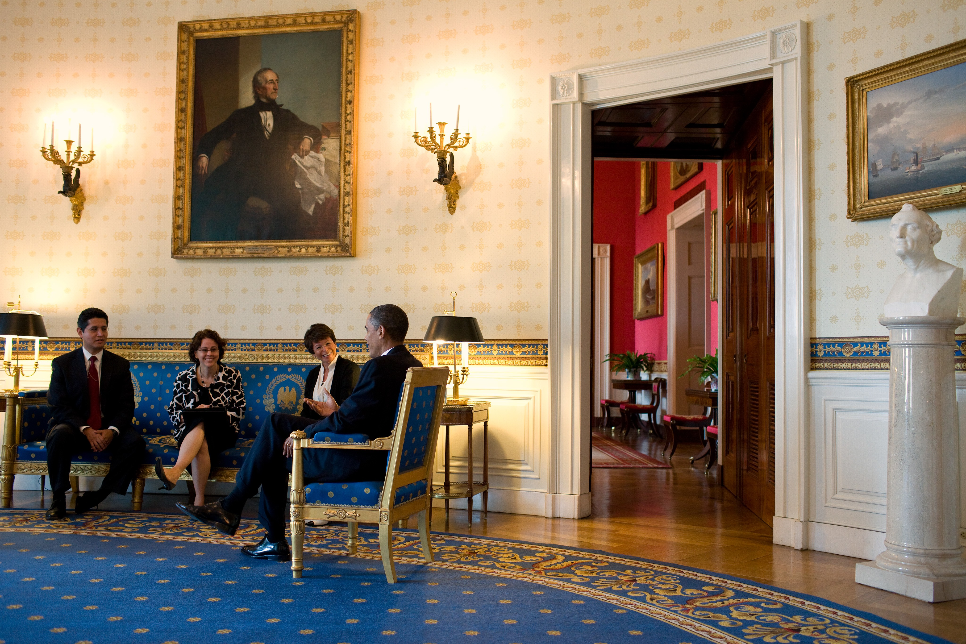 Four members of the task force meet together inside of the White House