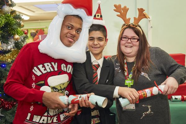 Asda Dagenham community champion Gemma Gray with students from Barking Abbey School