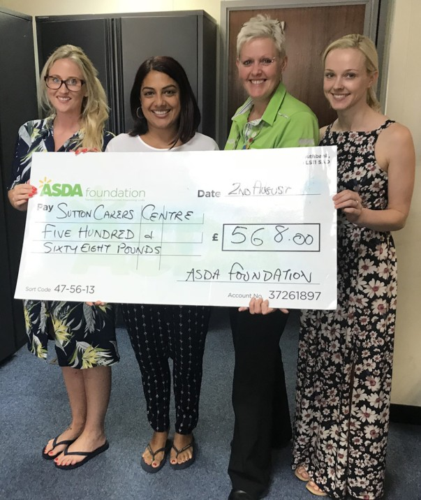 Tracey Jacques from Asda Sutton presenting a Healthy Holiday Fund grant to Sutton Carers Centre