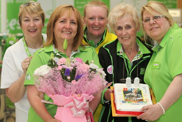 Colleagues help Margy celebrate her 80th birthday