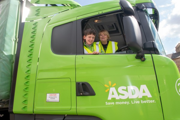 Young customer Aaron Maxwell with an Asda lorry and community champion Margaret Bradie at our Falkirk store