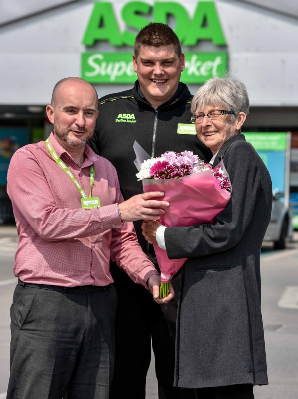 Asda Royston colleagues Richard Auty and Scott Lettin with customer Dot Broadley