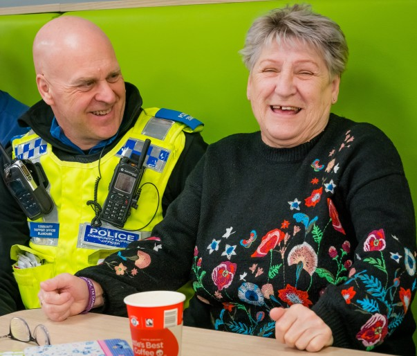 PCSO Colin Blanchard with a guest at Asda Warrington's community friendship group