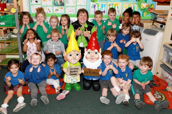 Asda Shirley community champion Sandra Grice with children from Tidbury Green Private Nursery