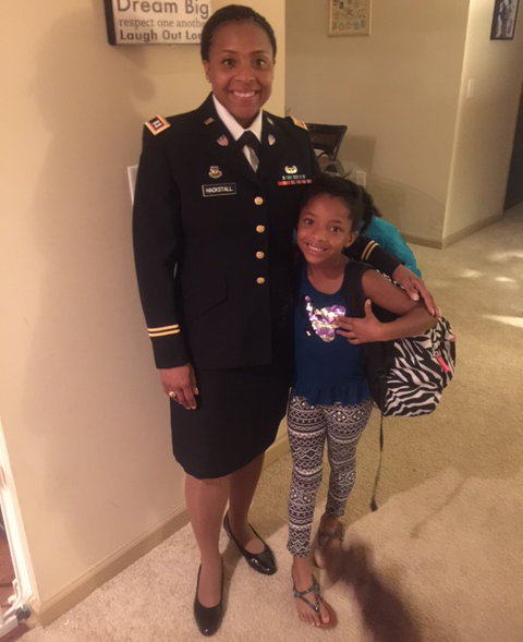 Elise Hackstall, Veteran and Walmart associate poses with her daughter
